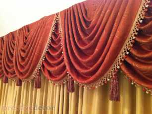 Silk drapery behind swags from rich fabric